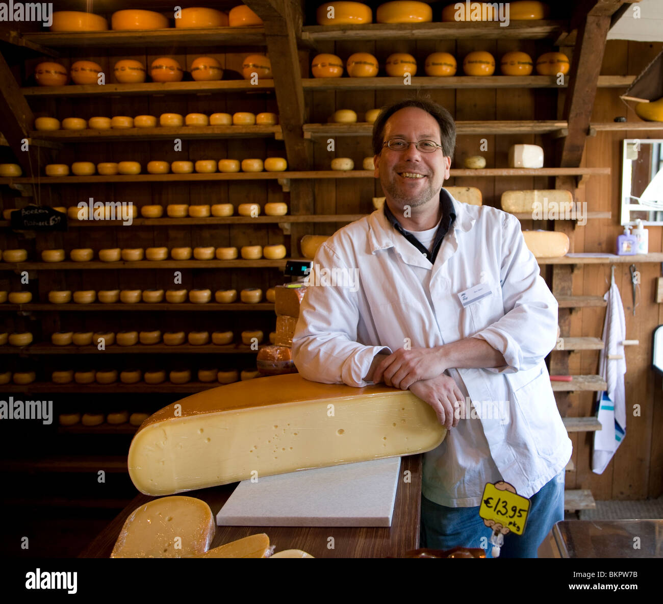 Shopkeeper in cheese shop and warehouse, Zuiderzee museum, Enkhuizen, Netherlands - Stock Image