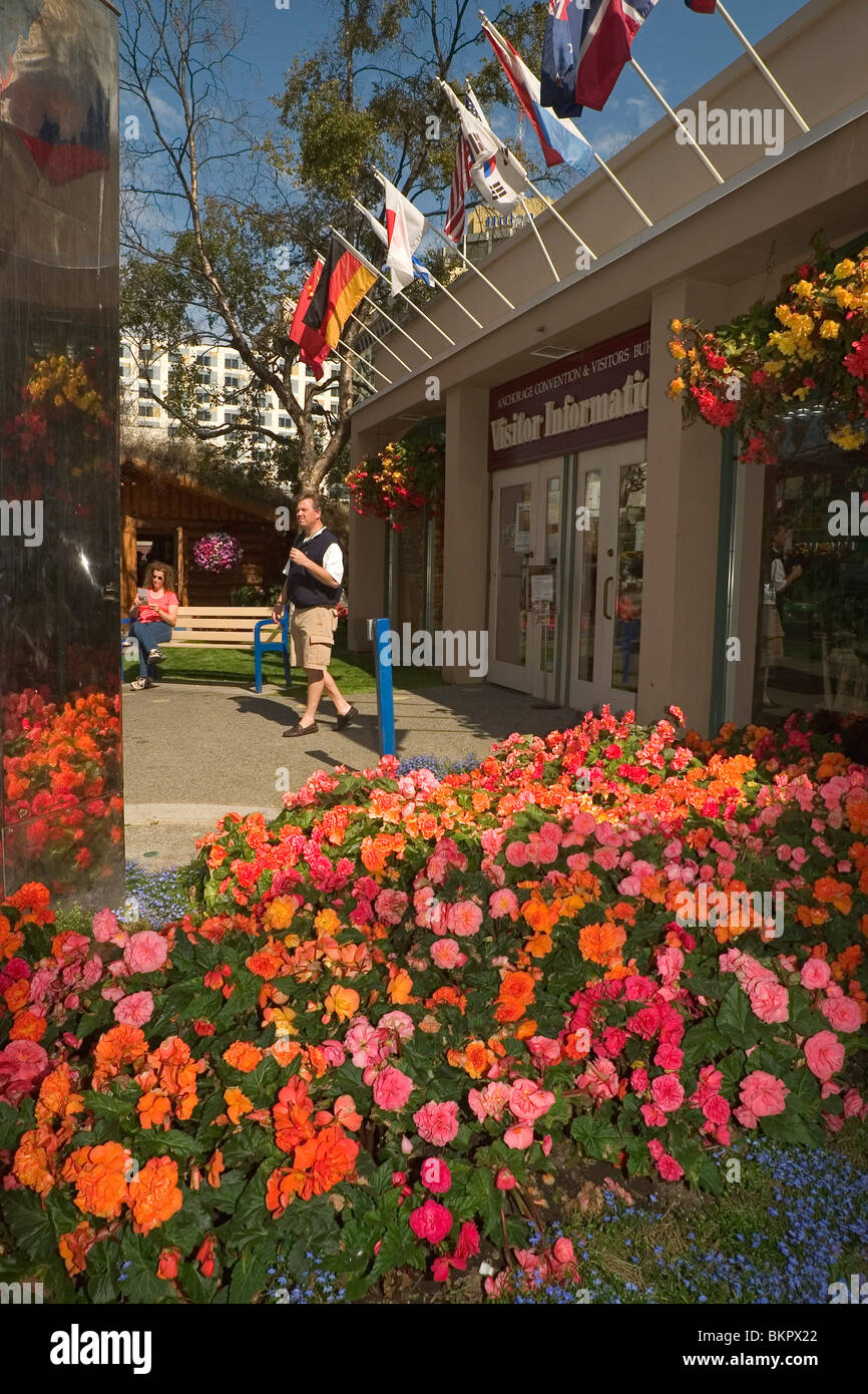 Woman Sits Outside Anchorage Visitor Center AK SC Summer Stock Photo ...