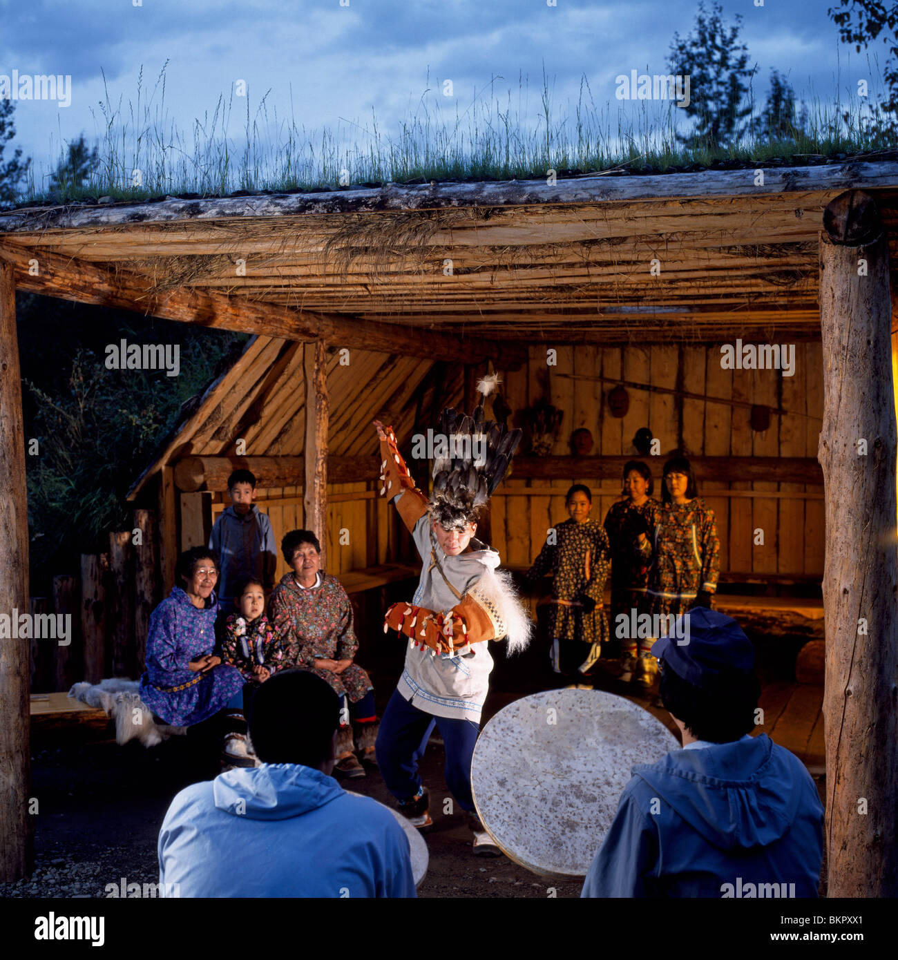 Male Native Inupiat Dancer Performs @ Community House AK Native Heritage Center - Stock Image