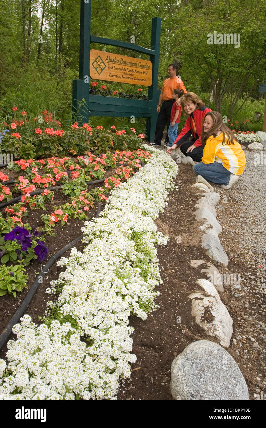 Family Enjoys Flower @ AK Botanical Garden Anchorage SC Summer - Stock Image