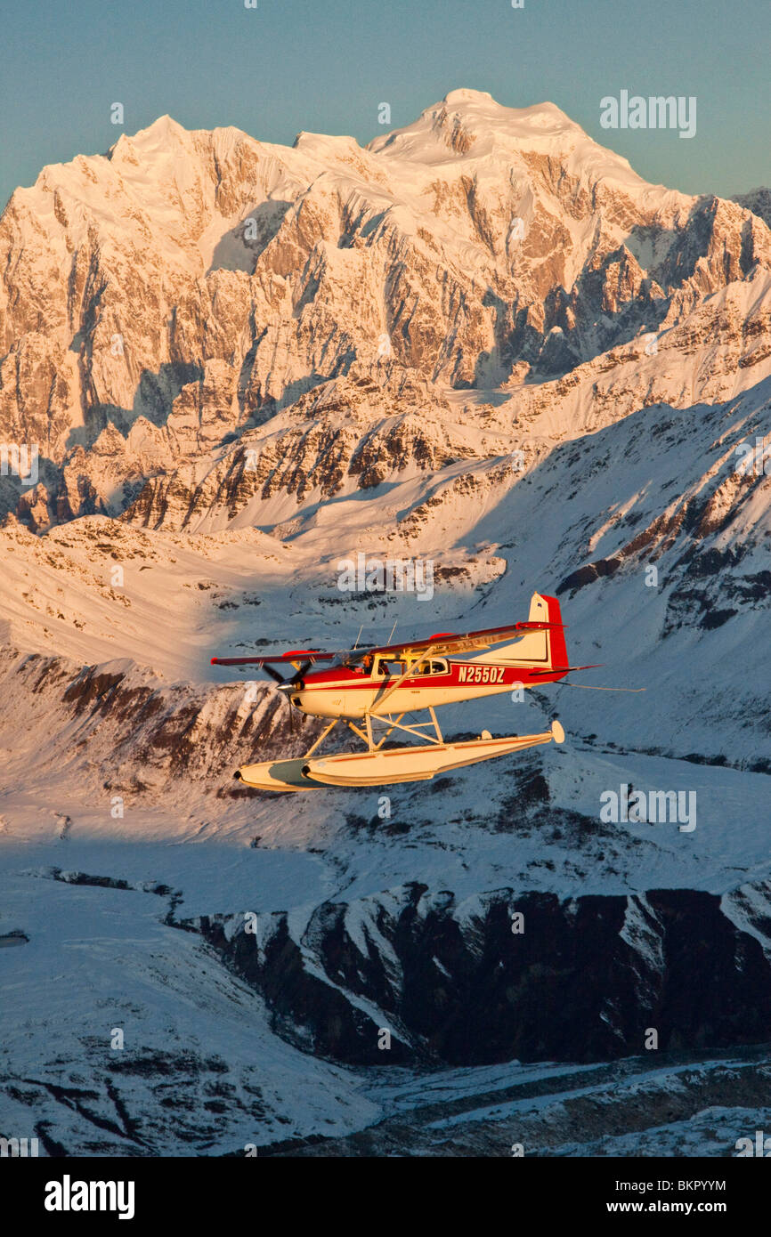 View of a Cessna 185 floatplane in Alaska Range over the Ruth