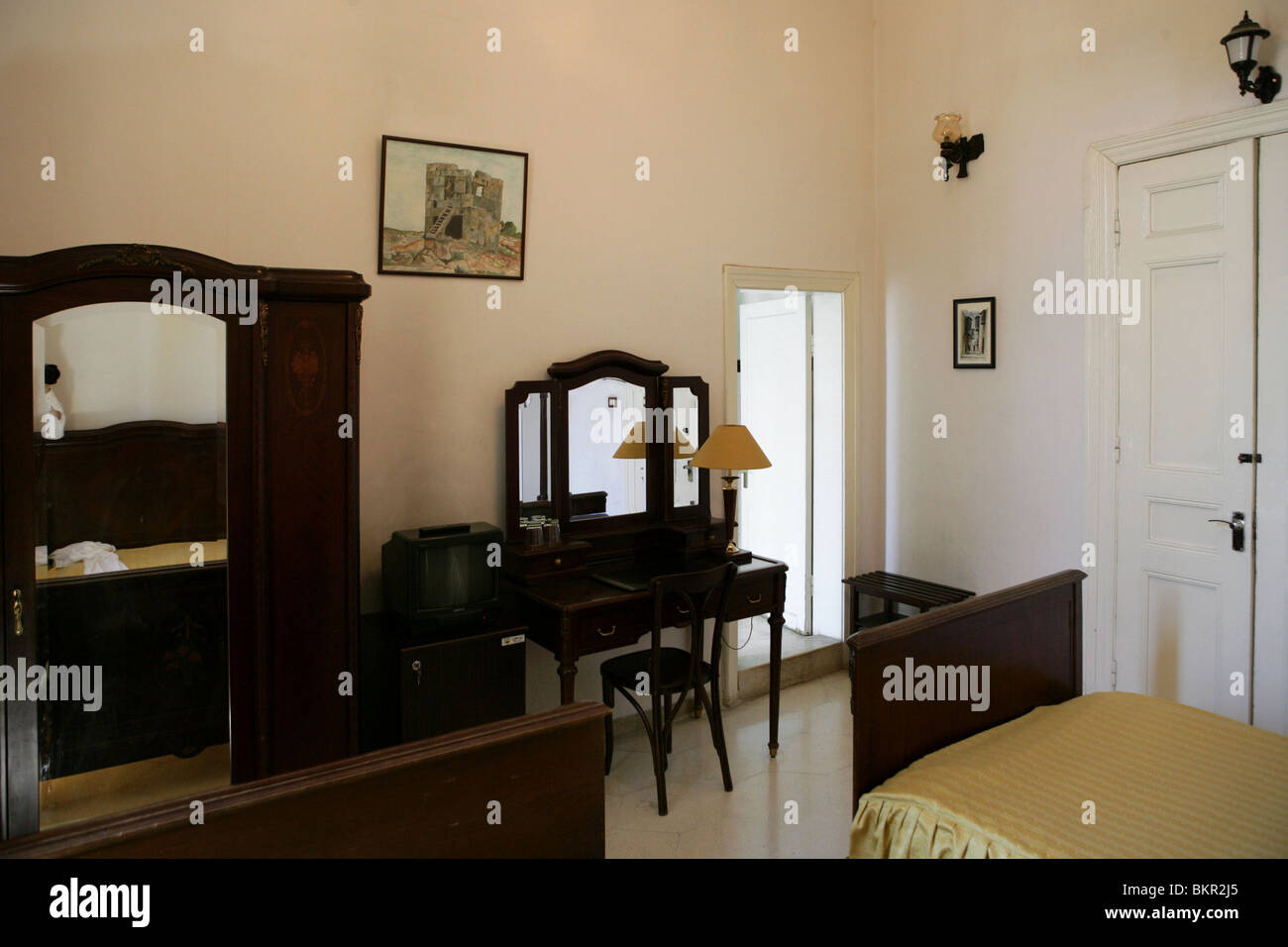 View of the bedroom,in which Agatha Christie stayed,  Baron Hotel, early 20th century, Aleppo, Syria. - Stock Image