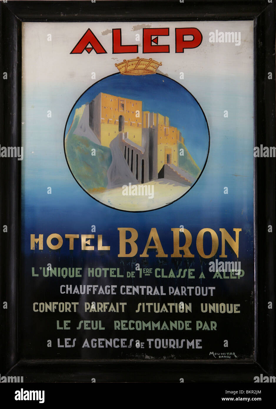 Old poster hanging in hall, Baron Hotel, early 20th century, Aleppo, Syria - Stock Image