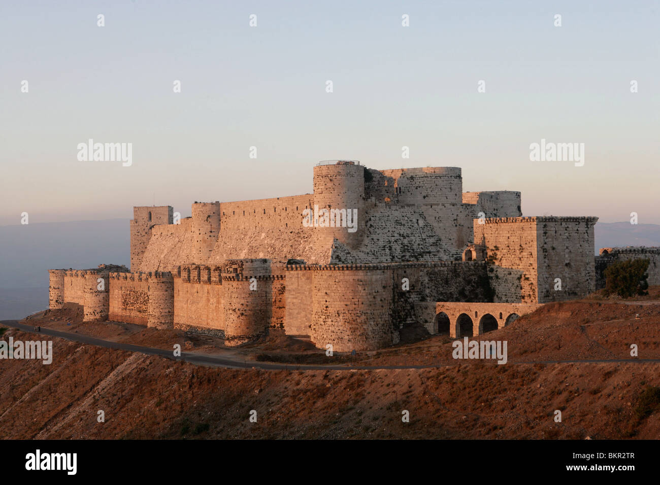 Krak des Chevaliers also known as Qala'at al-Husn, Homs Gap, Syria. The castle was built in 1031 for amir of - Stock Image