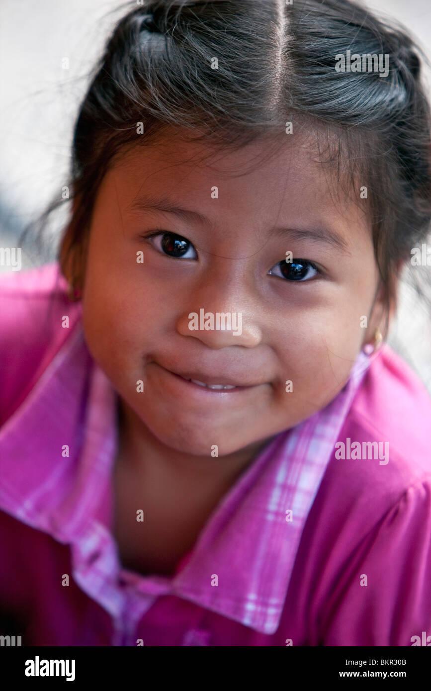 Ecuador, A pretty young girl at Otavalo market. - Stock Image
