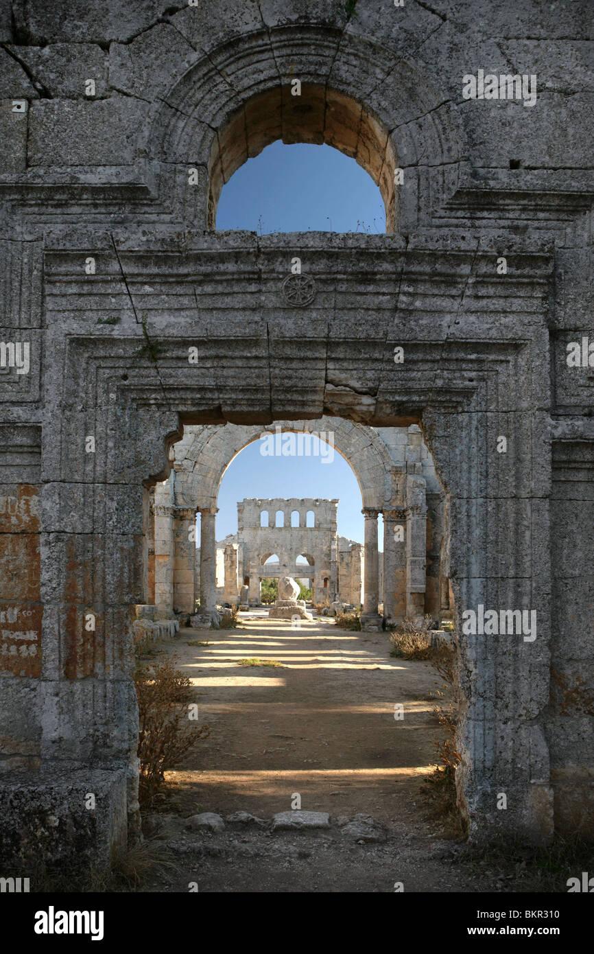 St Simeon's column seen through the doorway of the basilicas facade, St Simeon Stylite basilica, 473, Deir Samaan, - Stock Image