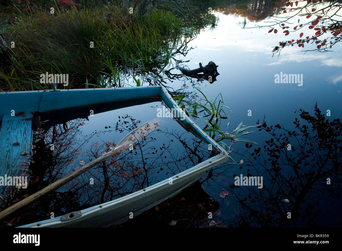 Flatboat with a paddle and early morning scene. Nantucket - Stock Image