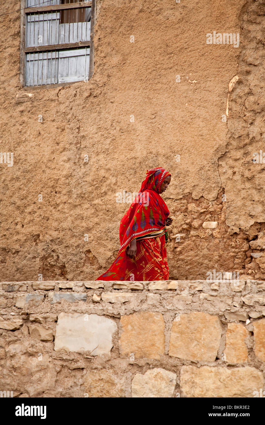 Ethiopia, Harar. A brightly-dressed Harari woman. - Stock Image