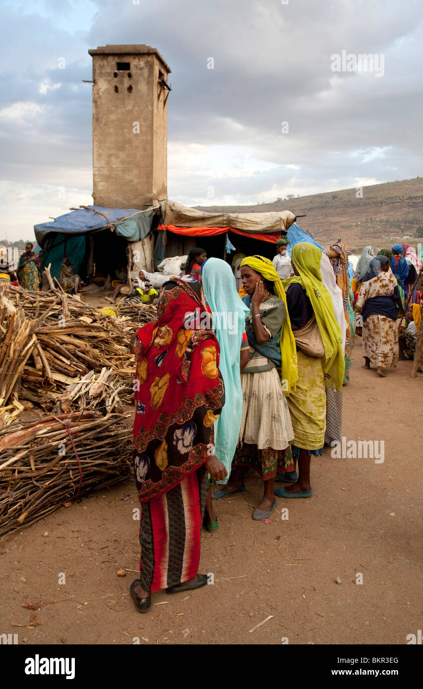Ethiopia, Harar. Harari women buy and sell firewood. - Stock Image