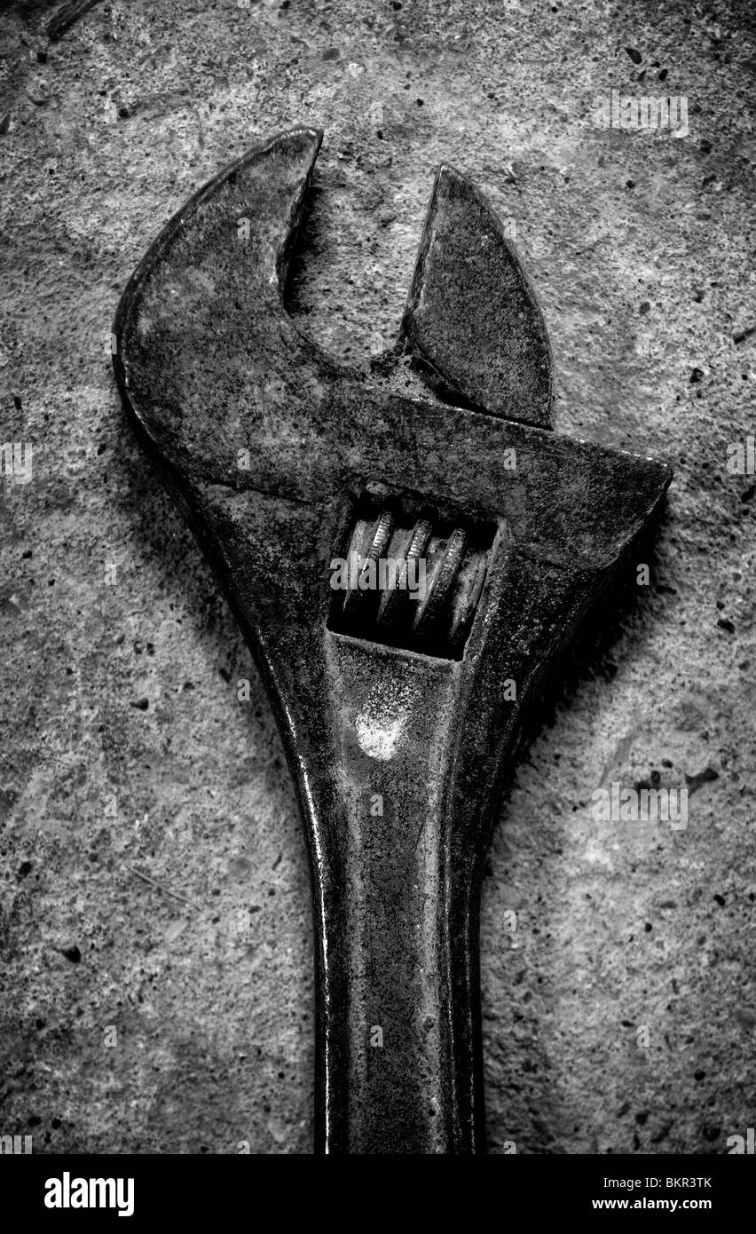 A Spanner Wrench Photographed On A Concrete Floor Stock Photo