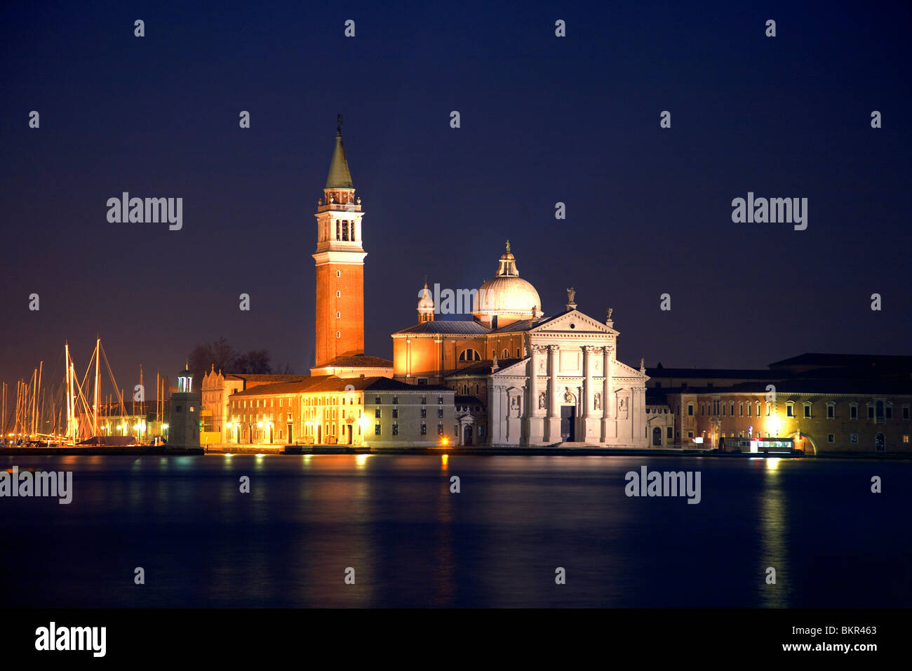Italy, Veneto, Venice; The Church prominently lit during the night, across the Bacino di San Marco - Stock Image