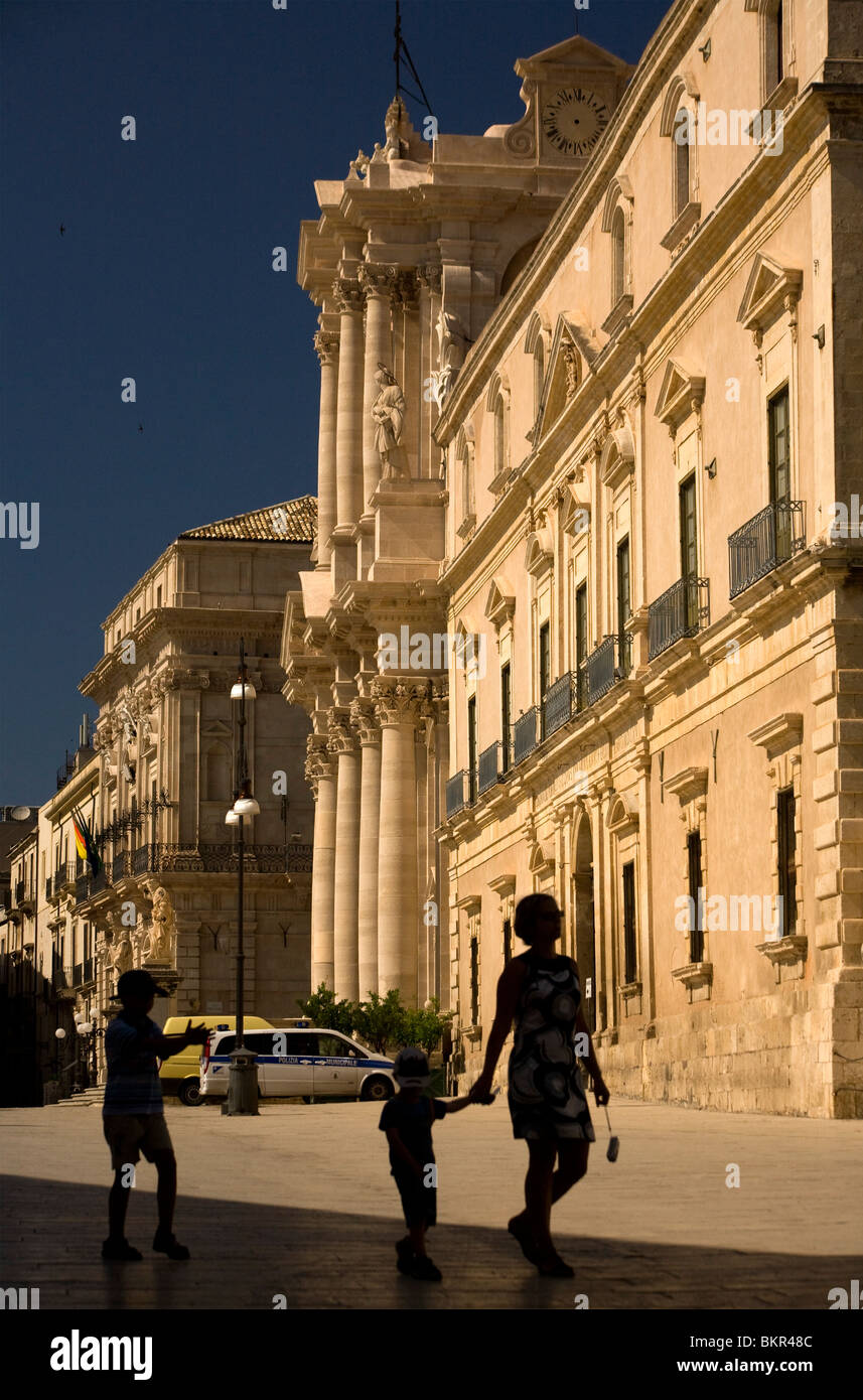 Siracusa, Sicily, Southern Italy; A family walking in the main square of Ortigia, Siracusa's historical core - Stock Image