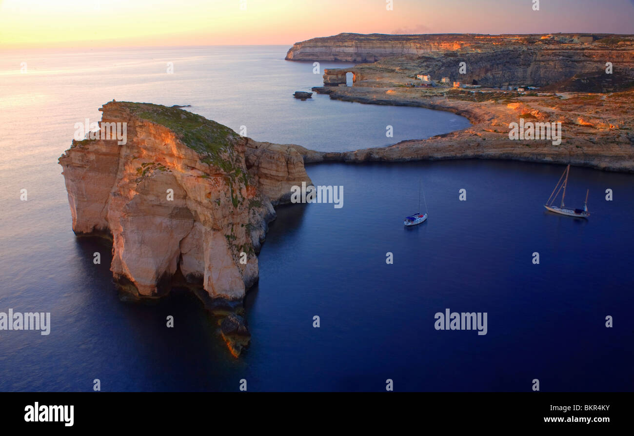 Malta, Gozo, Dwejra; 'Fungus Rock' Named so, because of the plant growing on it. - Stock Image