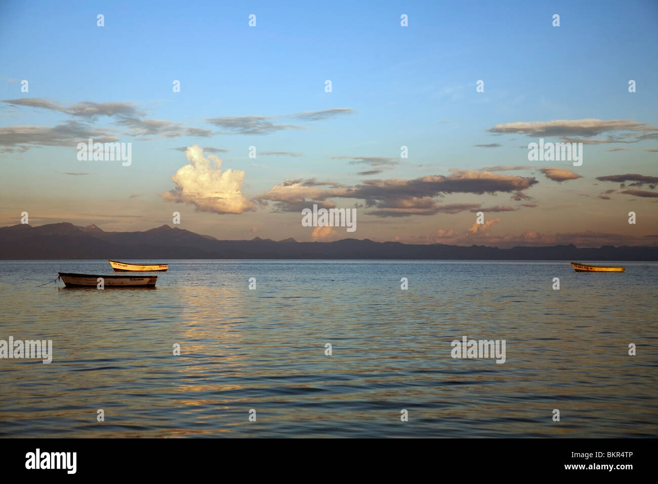 Malawi, Monkey Bay. Boats on the calm waters of Lake Malawi at sunset. - Stock Image