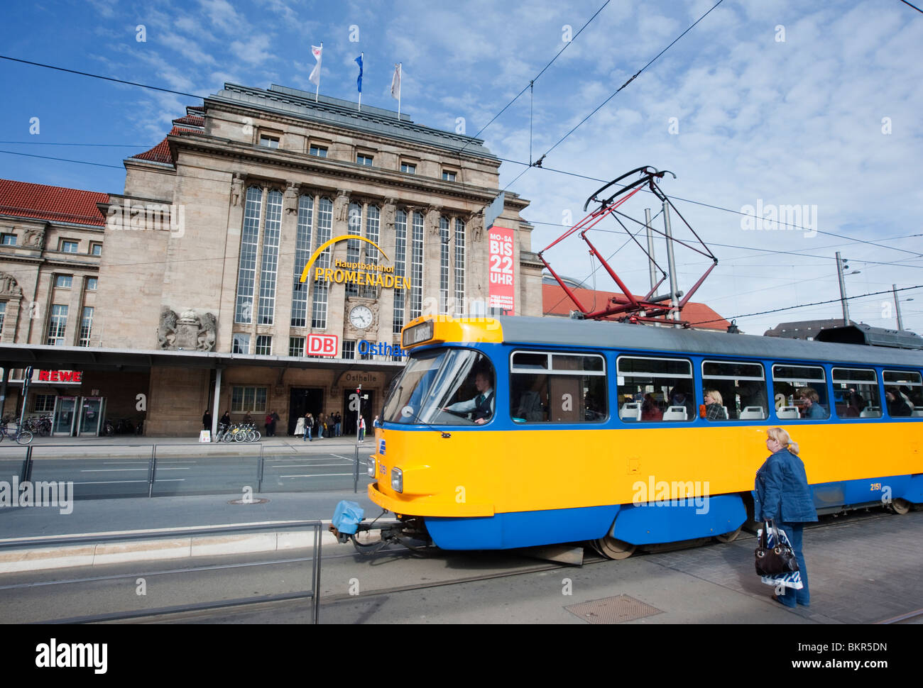 Tram passing main railway station or Hauptbahnhof in Leipzig Germany - Stock Image