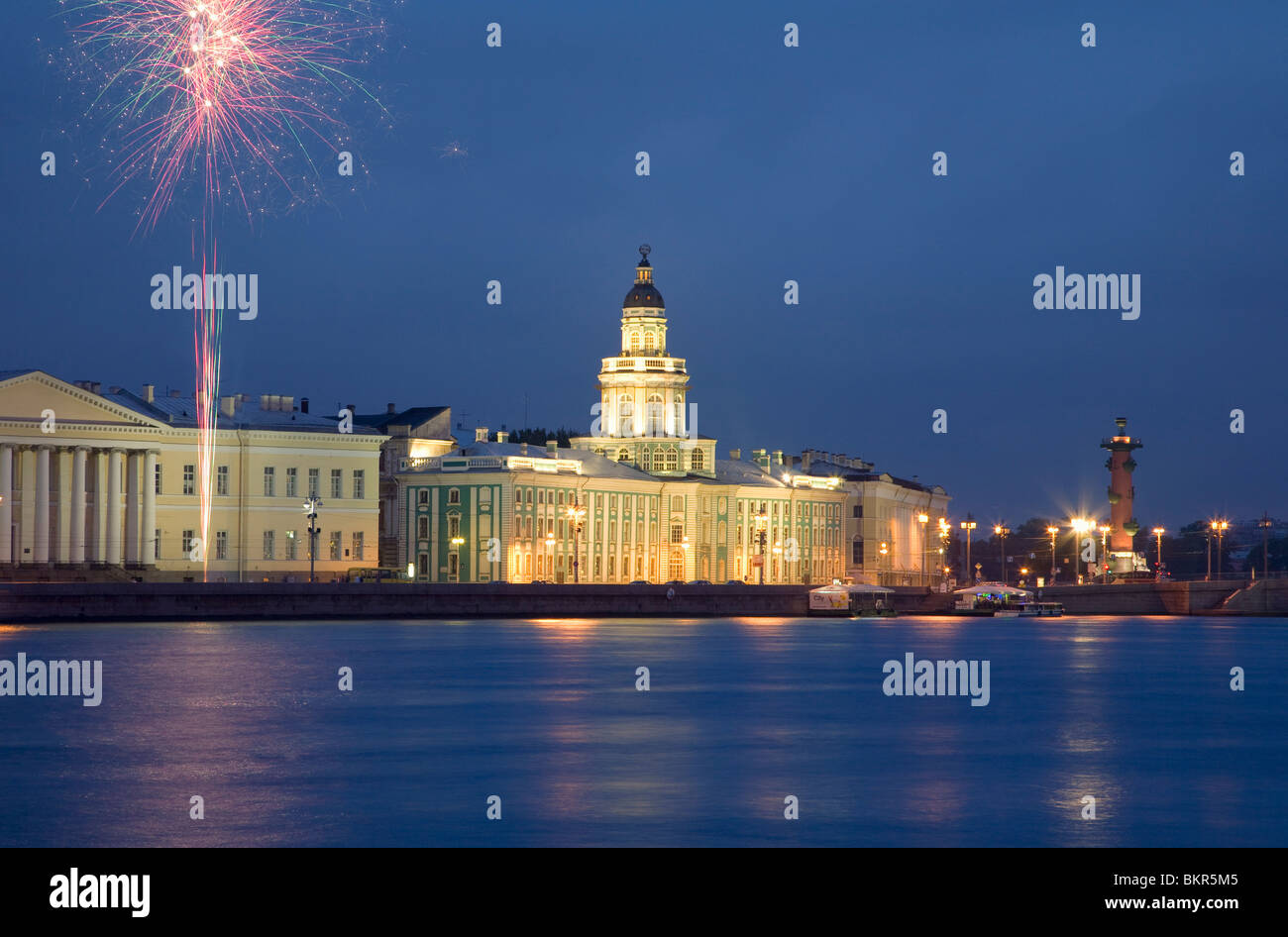 Russia, St.Petersburg; Across the Neva River with the Kunstkamera and a Rostral column while fireworks are being - Stock Image