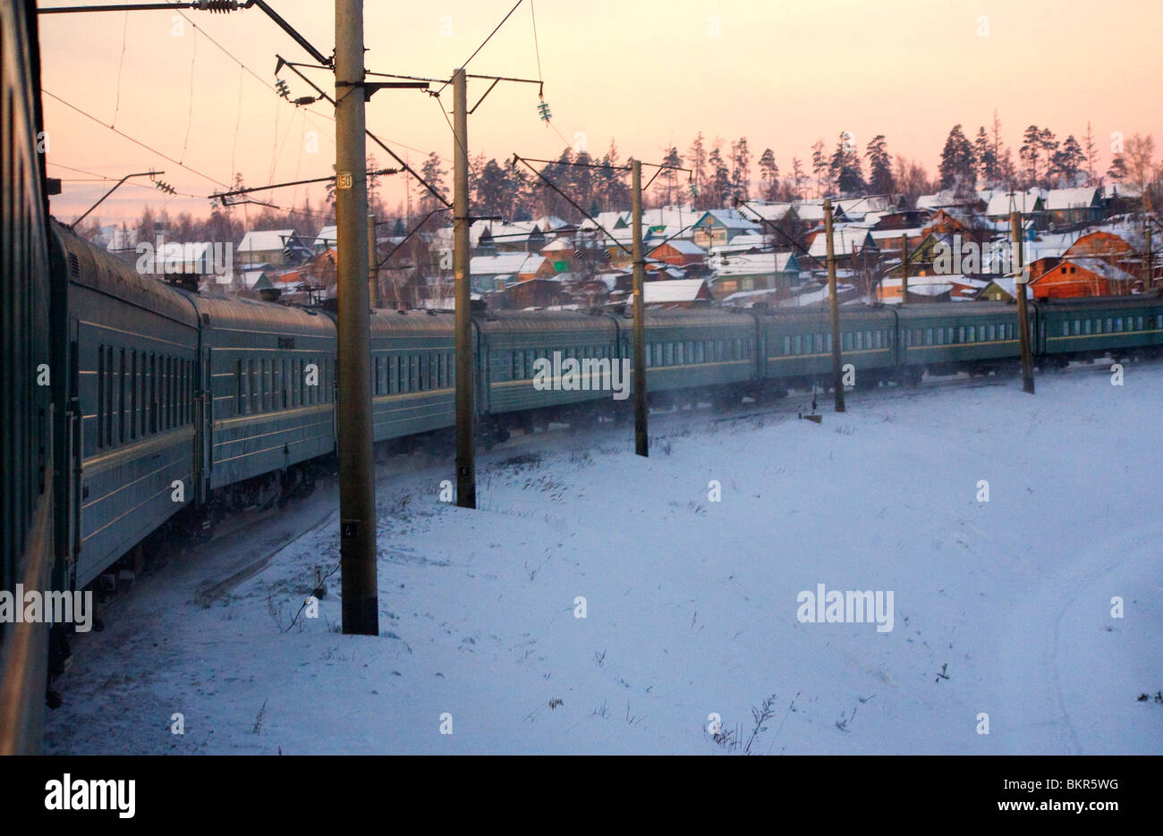 Russia, Siberia, Trans-Siberian; The train swiftly moving on the Trans-Siberian trail amidst the Siberian snow and - Stock Image
