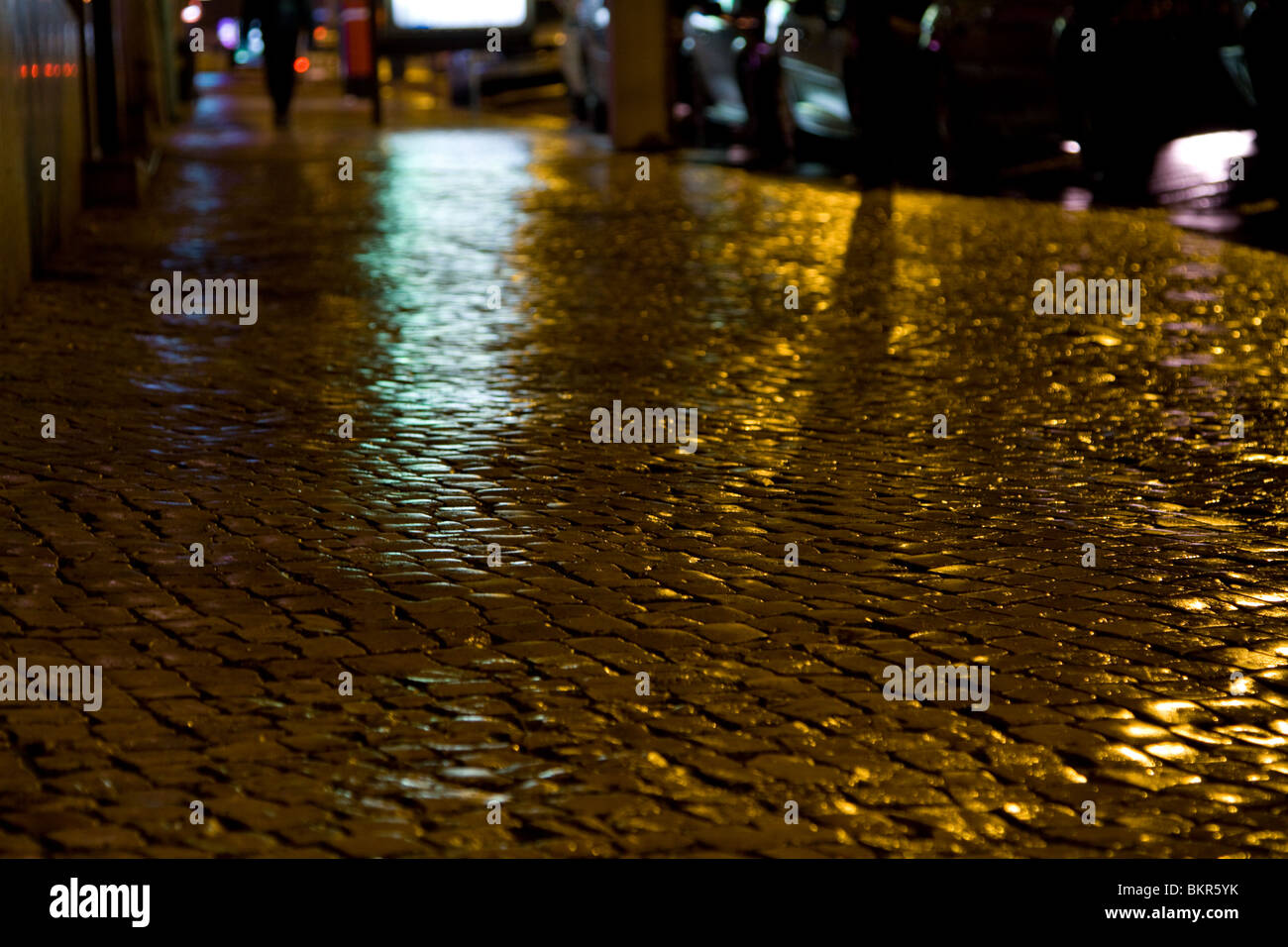 The glistening cobblestone streets in the evening, after a rain. - Stock Image