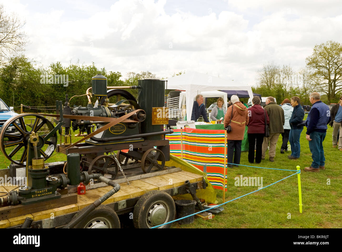 country county show with traction engine in foreground and onlookers in background, Devon England UK 2010 - Stock Image