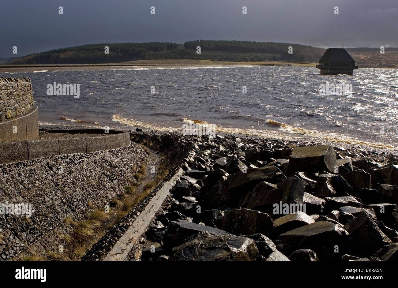 Kielder Water reservoir and dam from Yarrowmoor with valve tower in stormy weather, UK - Stock Image