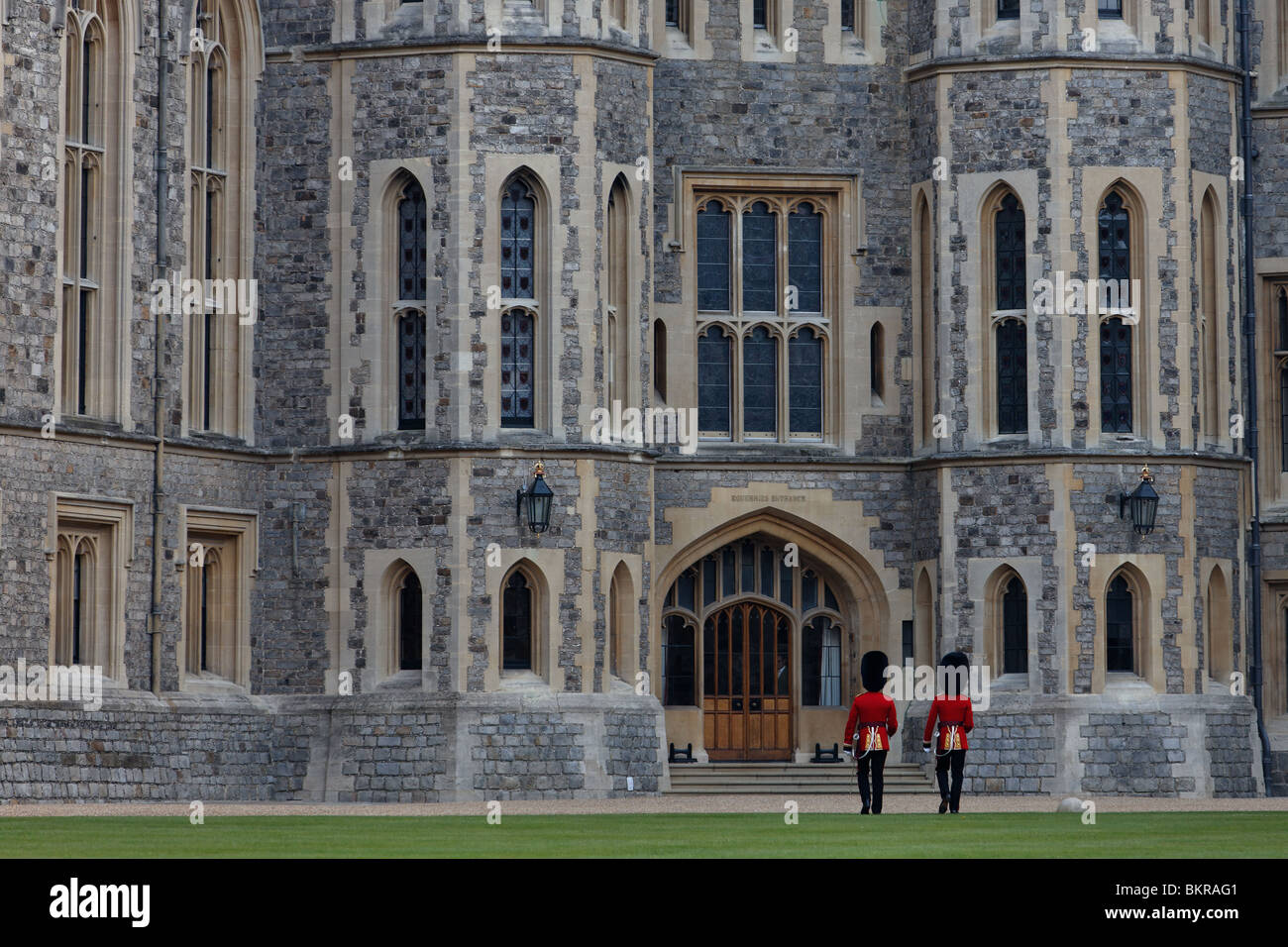 Two Welsh Guardsmen at Windsor Castle, approaching the Equarries Entrance of The State Apartments - Stock Image