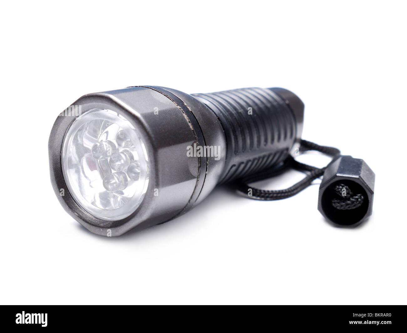 Portable LED flashlight shot over white background - Stock Image