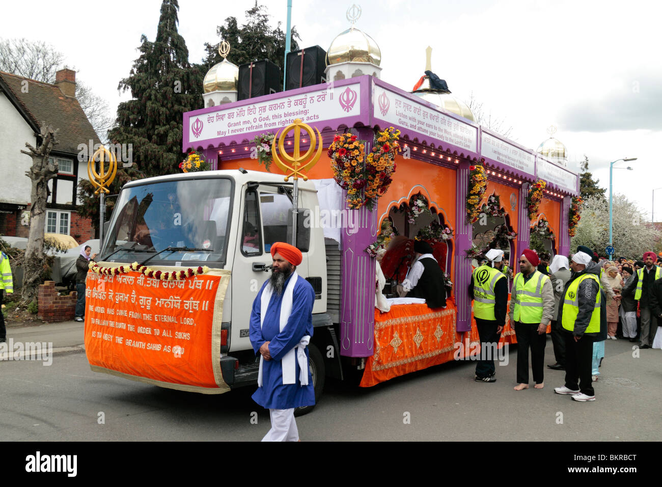 The Sri Guru Granth Sahib (Sikh holy book) beign escorted at the annual Vaisakhi Nagar Kirtan (procession) Hounslow, - Stock Image