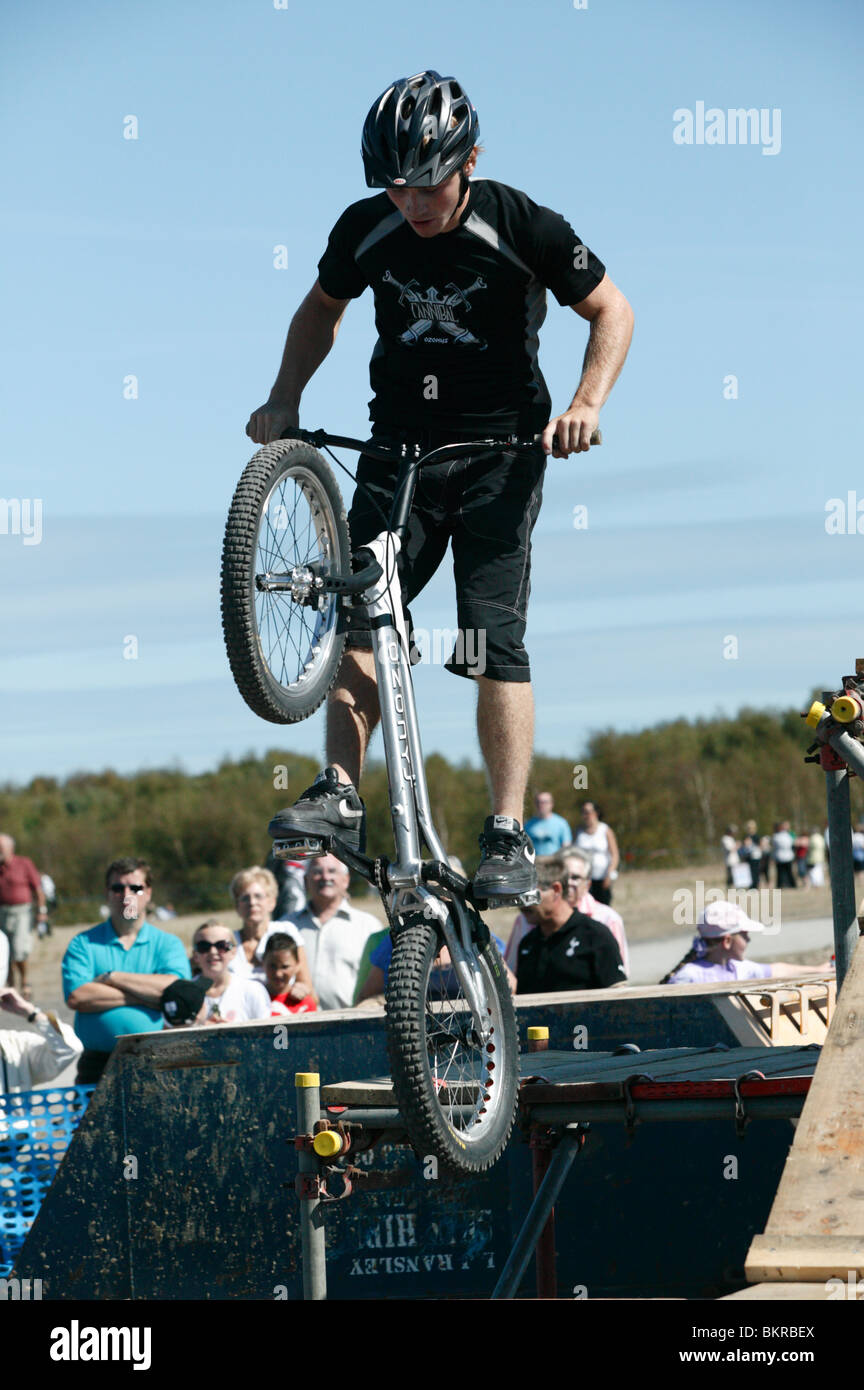 BMX Cycle Rider performs aerial stunts at the 2009 Bank Holiday Mining Heritage Festival at Fowlmead Country Park, - Stock Image