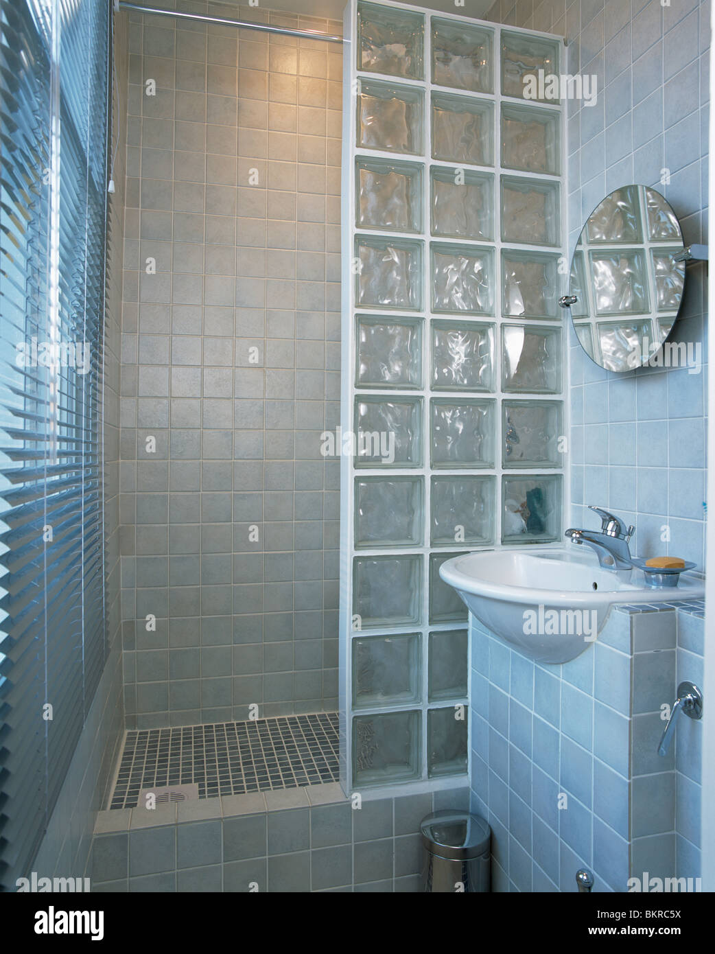 Glass brick shower wall in small modern tiled bathroom with Stock ...
