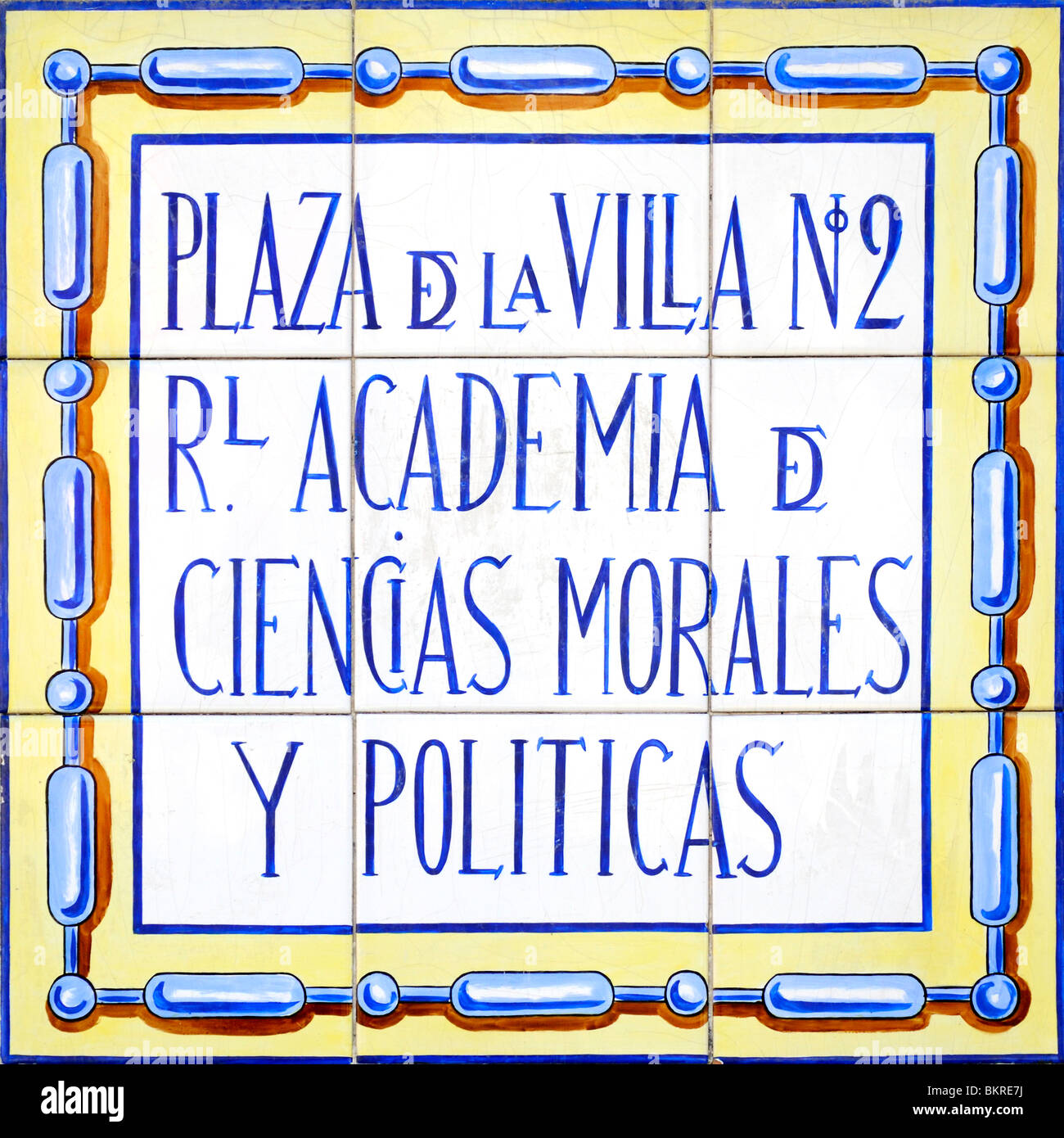 Madrid, Spain. Painted tiled sign on the Royal Academy of Moral and Political Sciences - Stock Image