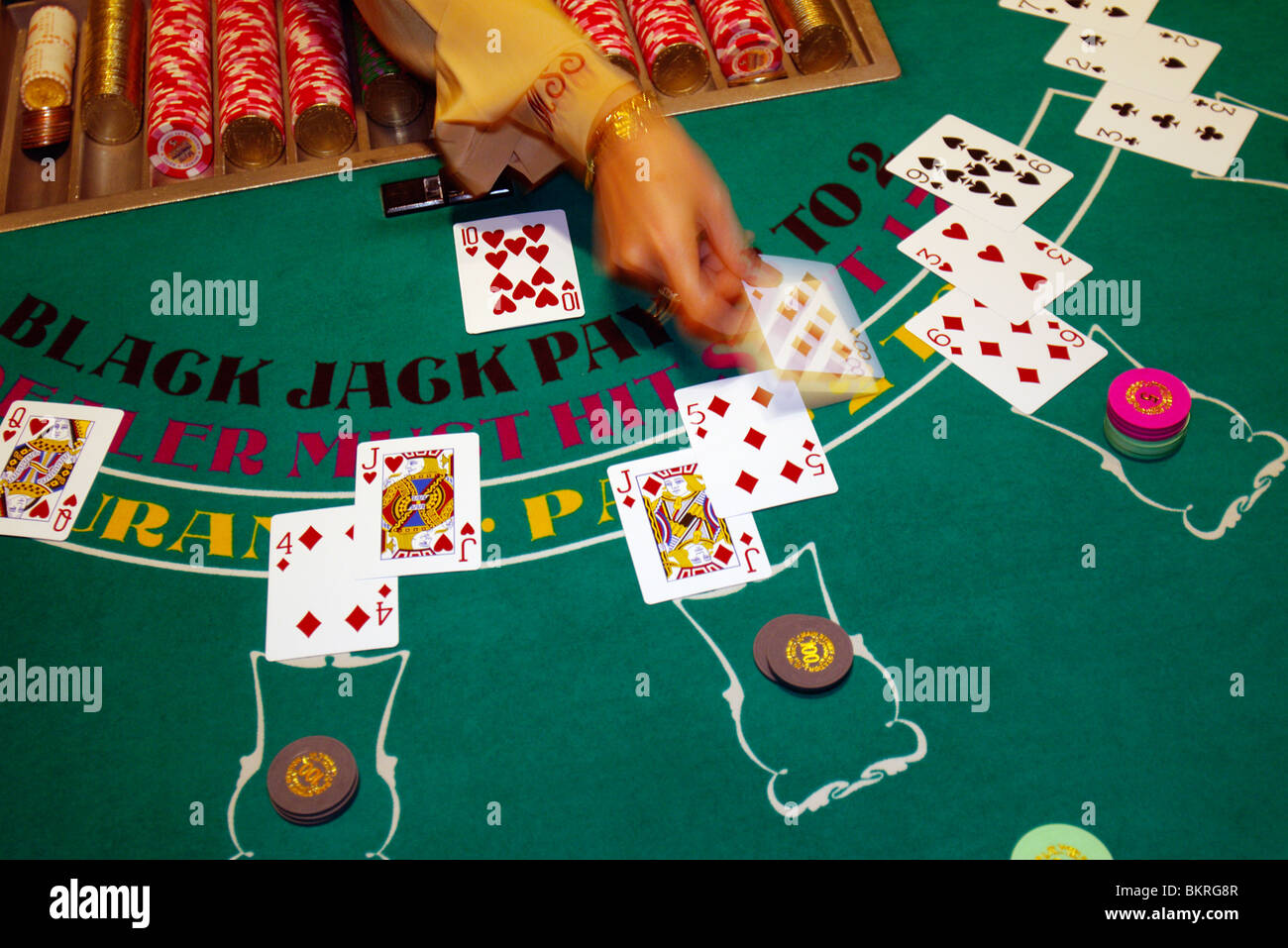 Dealing blackjack in a casino paper and ribbon slot punching tool