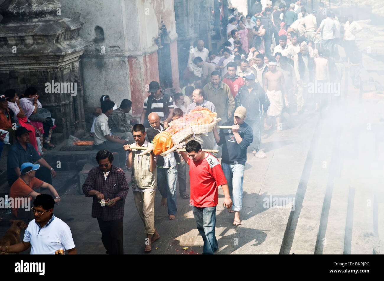 A body headed for cremation in Kathmandu's Pashupatinath temple. - Stock Image