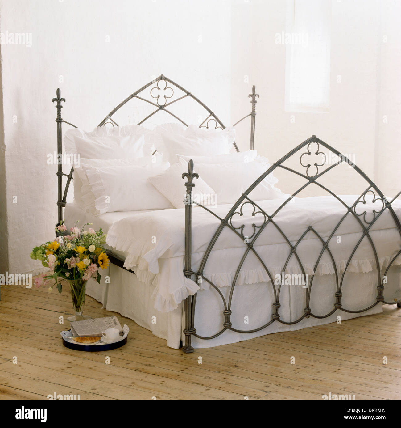 Picture of: Gothic Style Black Wrought Iron Bed With White Linen In Modern White Stock Photo Alamy