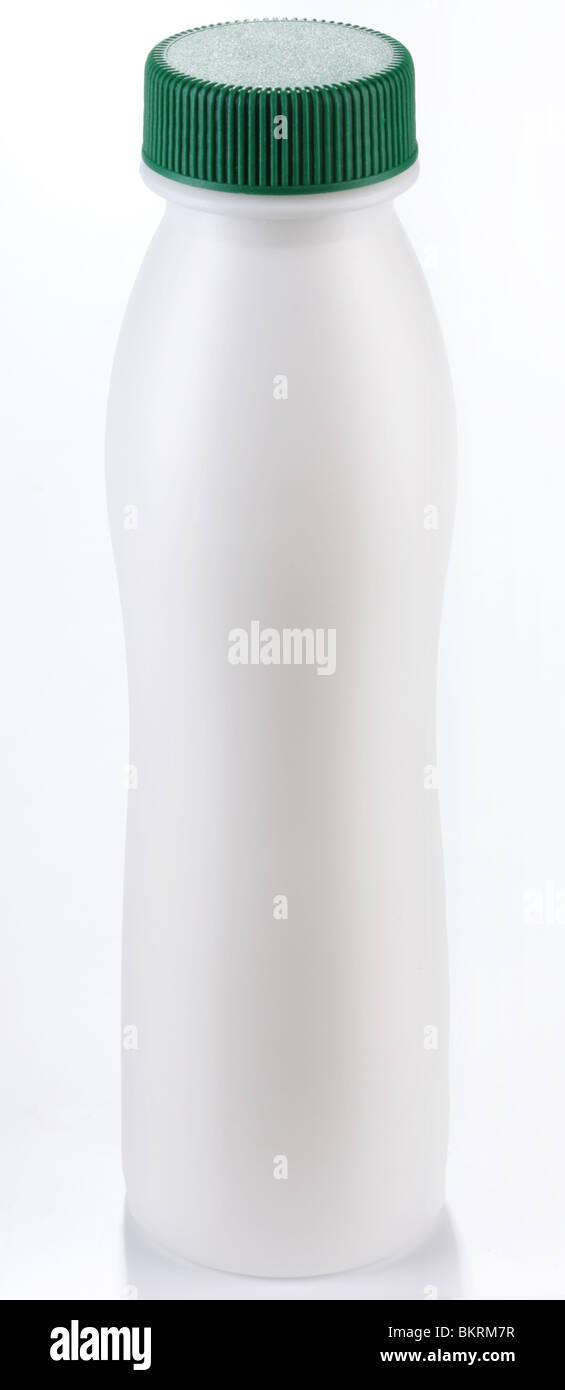 plastic bottle of milk on a white background - Stock Image