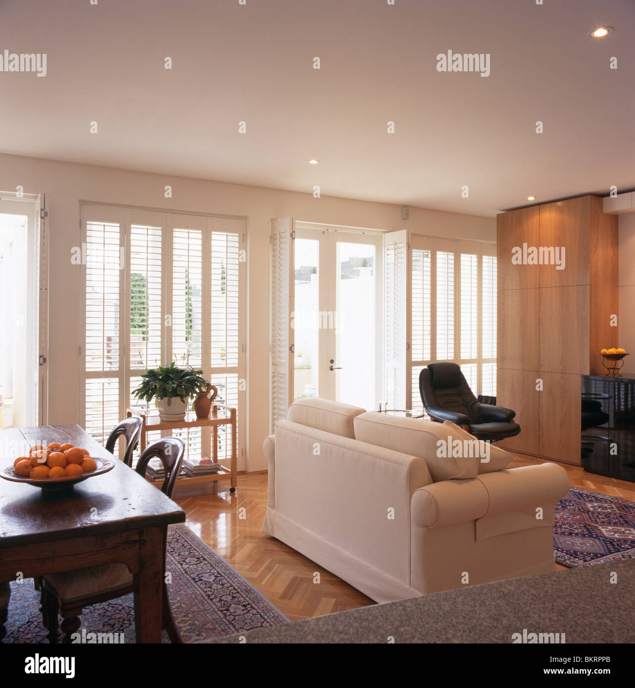 White Sofa In Large Modern White Living And Dining Room With