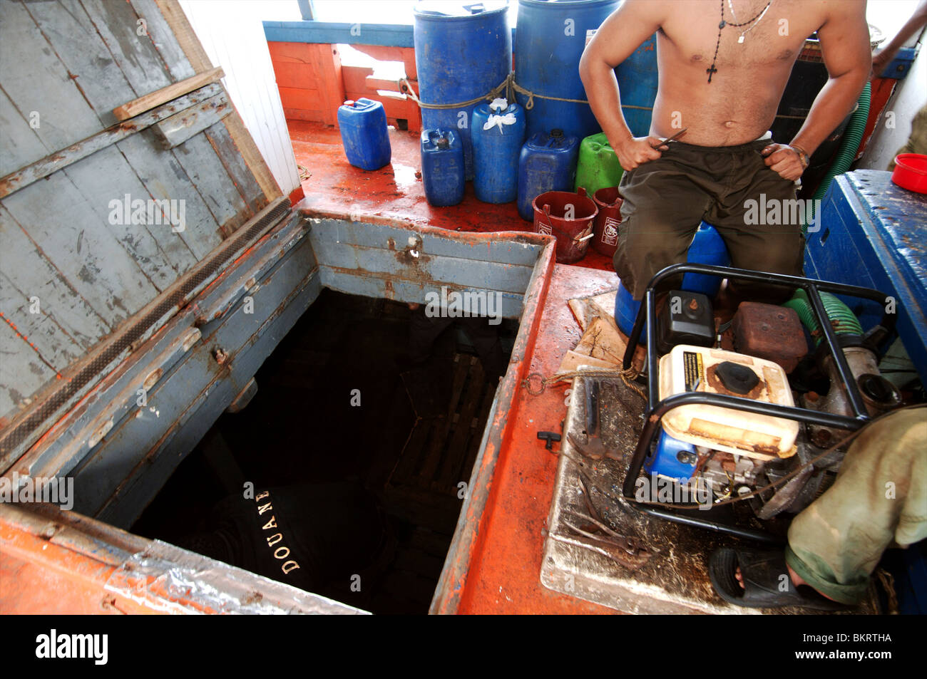 Curacao Willemstad, custom officers searching boats for drugs and contraband - Stock Image