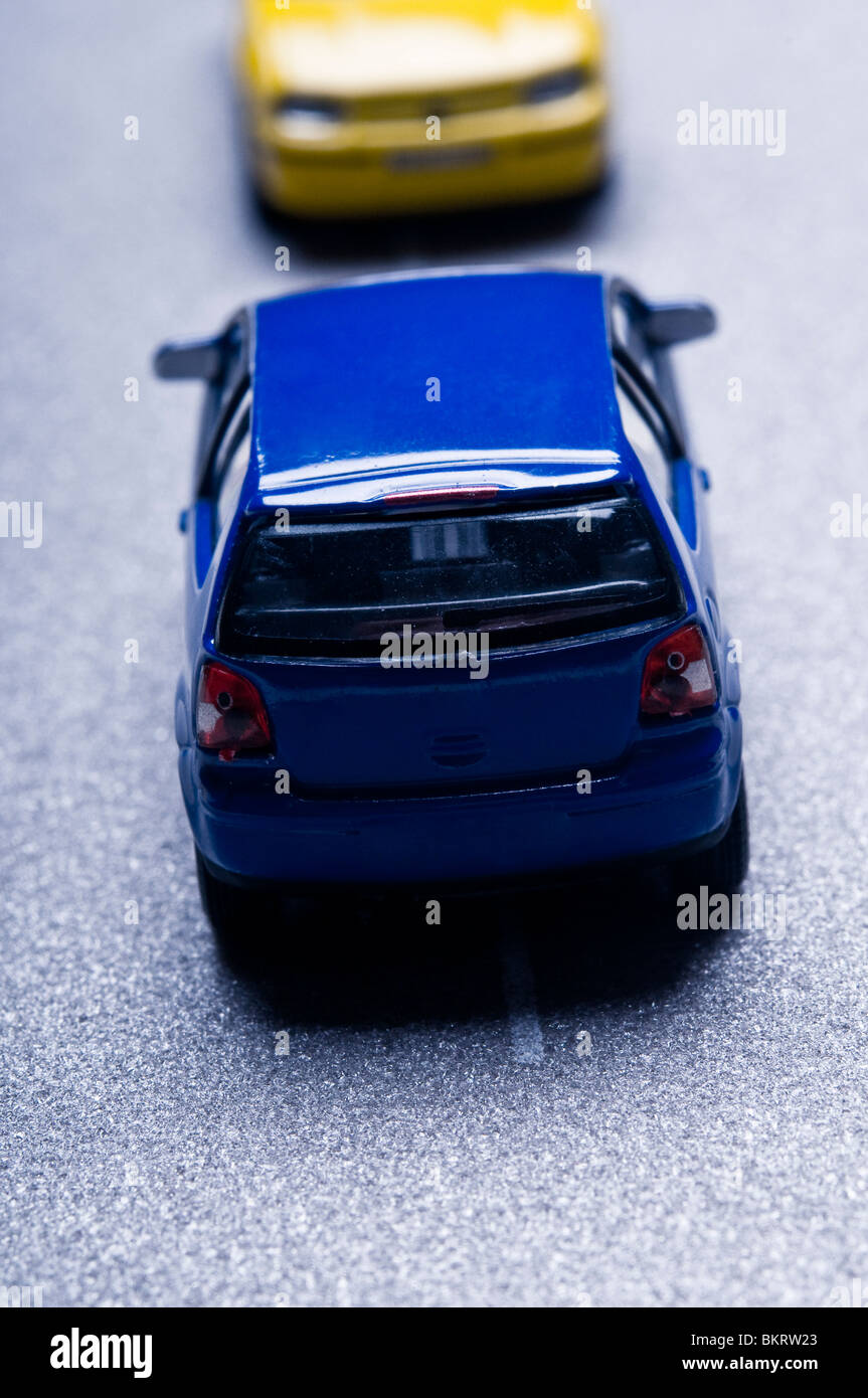 car toy models simulating a traffic collision - Stock Image
