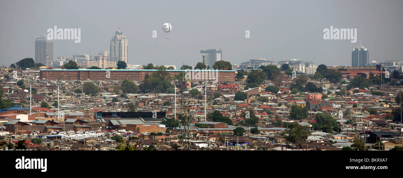 View over Township Alexandra on to luxury district Sandton City in the background with its hotels and shopping complexes - Stock Image