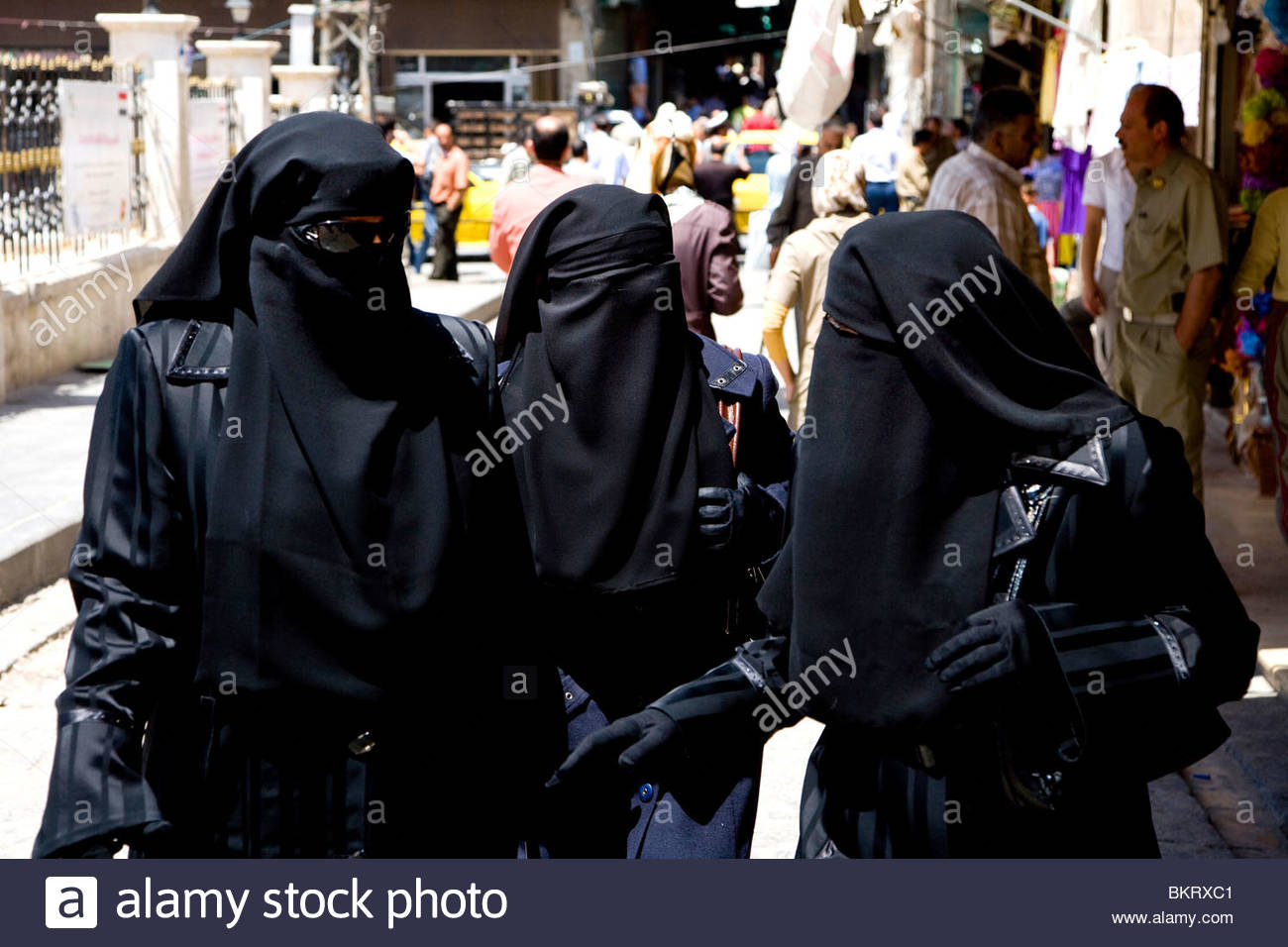women with niqab,Aleppo,Syria,Middle East,Asia - Stock Image