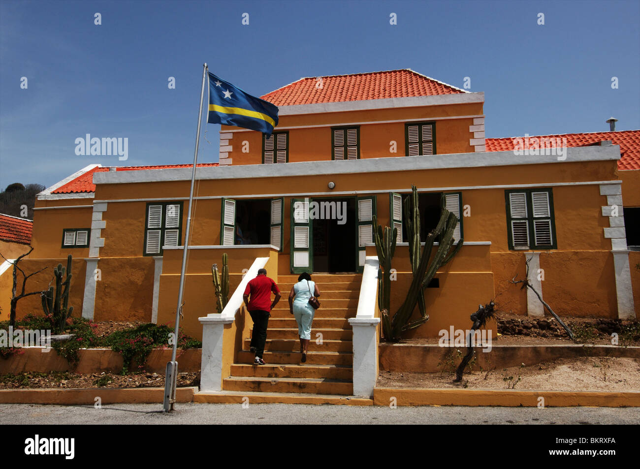 Curacao, visiting local krioyo restaurant is a big social affair on sundays - Stock Image