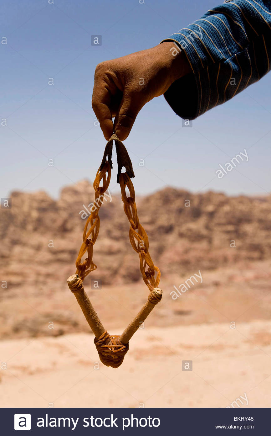 Bedouin with sling,Petra,Jordan,Middle East,Asia - Stock Image
