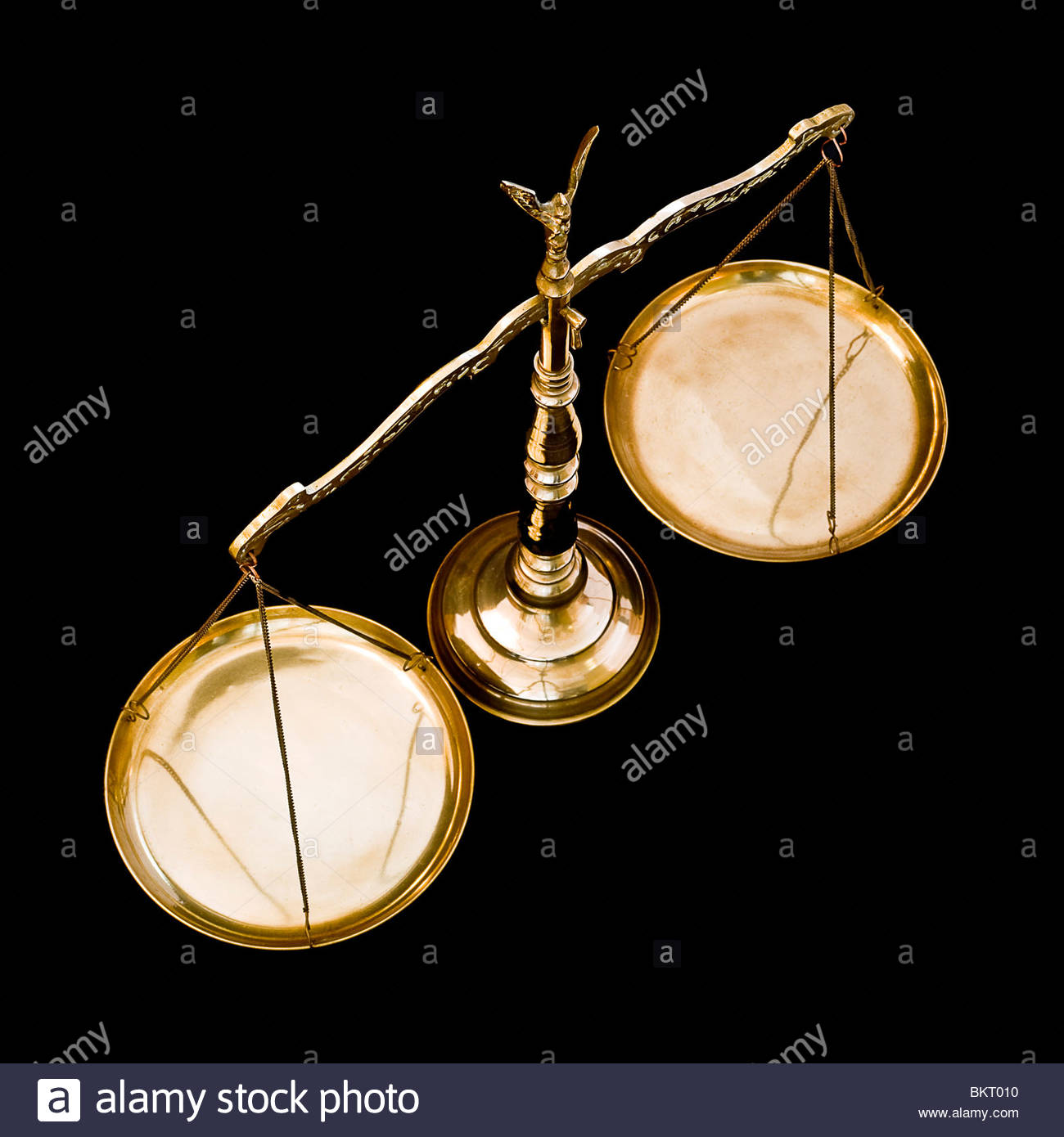 Brass weighing scales on black background - Stock Image