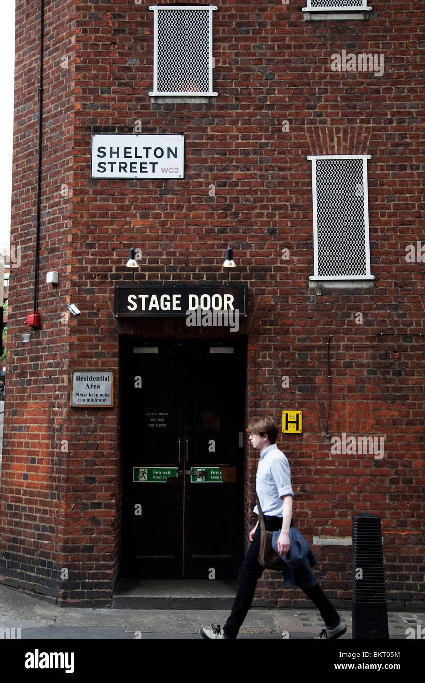 Covent Garden in the West End of London. Passing the rear stage door entrance to the Cambridge Theatre on Shelton Street & Covent Garden in the West End of London. Passing the rear stage door ...