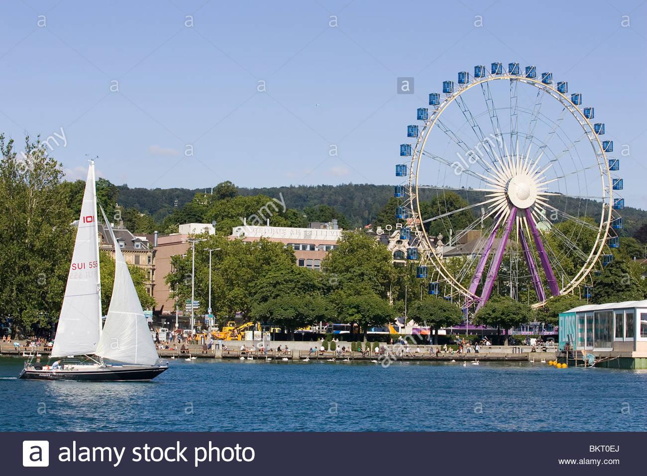 Ferris wheel and sailing,Lake Zurich,Zurich,Switzerland - Stock Image