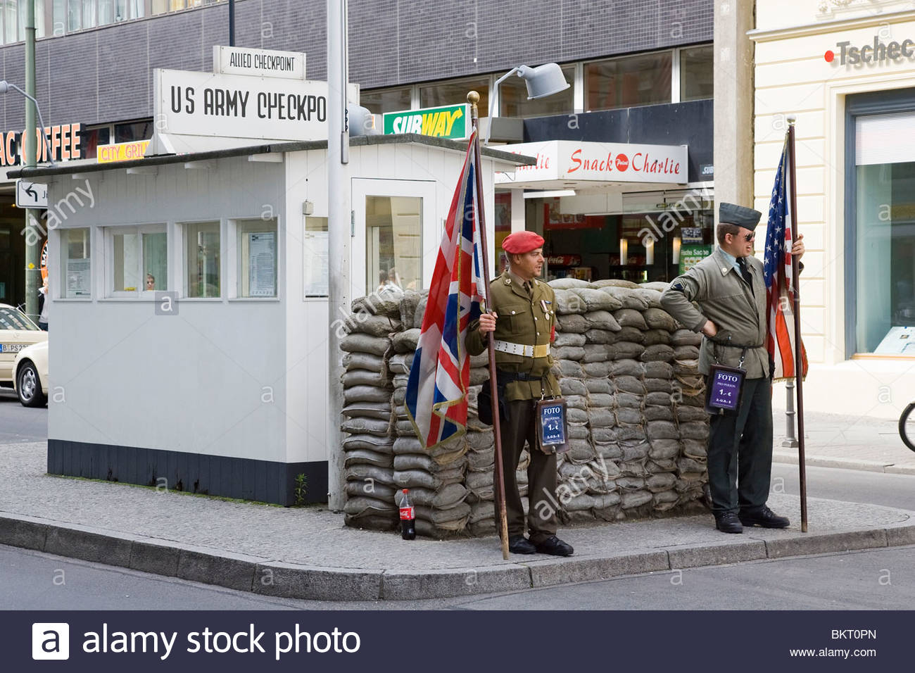 fake soldiers are photographed by tourists,Checkpoint Charlie,Berlin,Germany - Stock Image