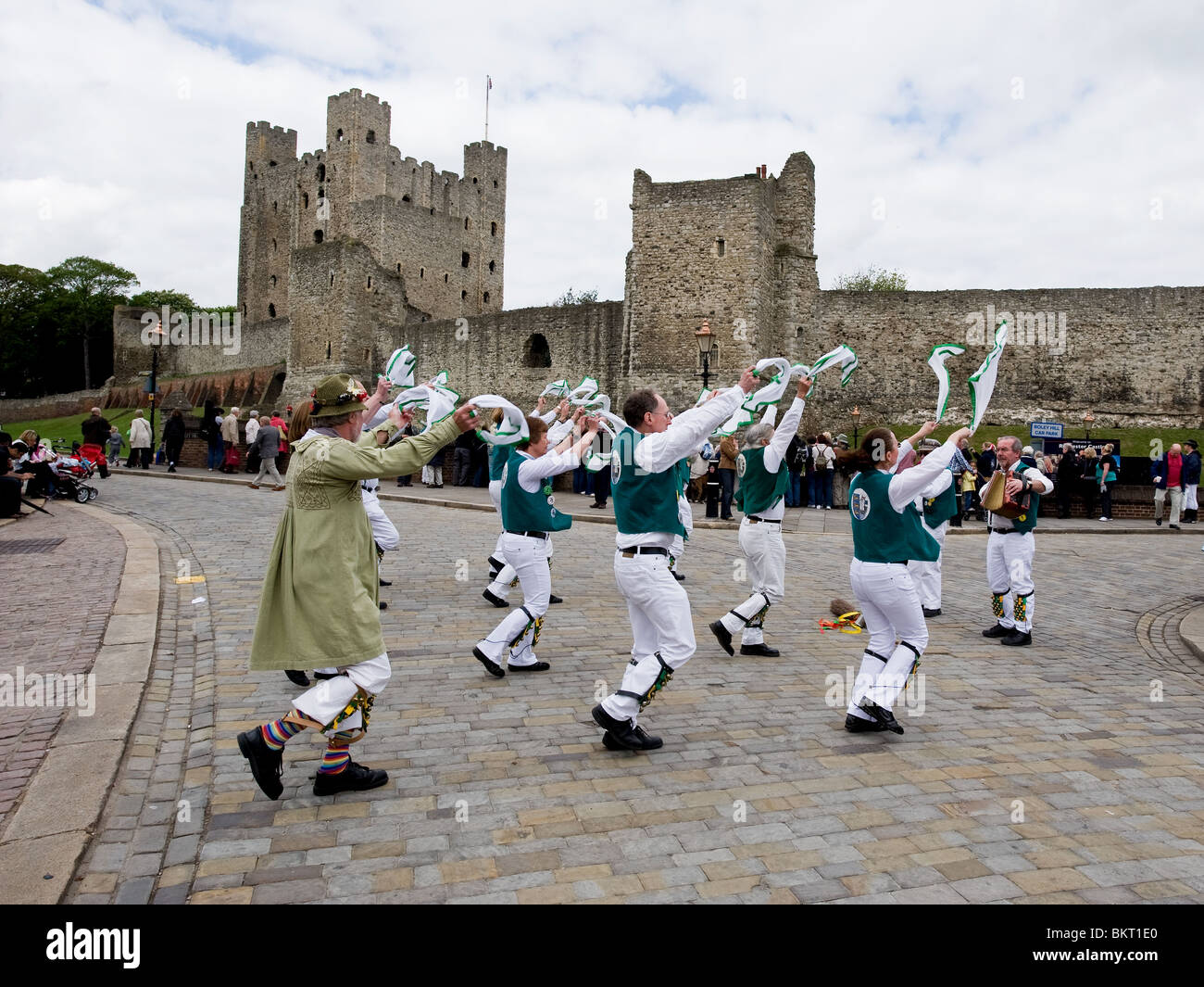 Morris dancing near Rochester Castle at the Sweeps Festival in Rochester in Kent - Stock Image