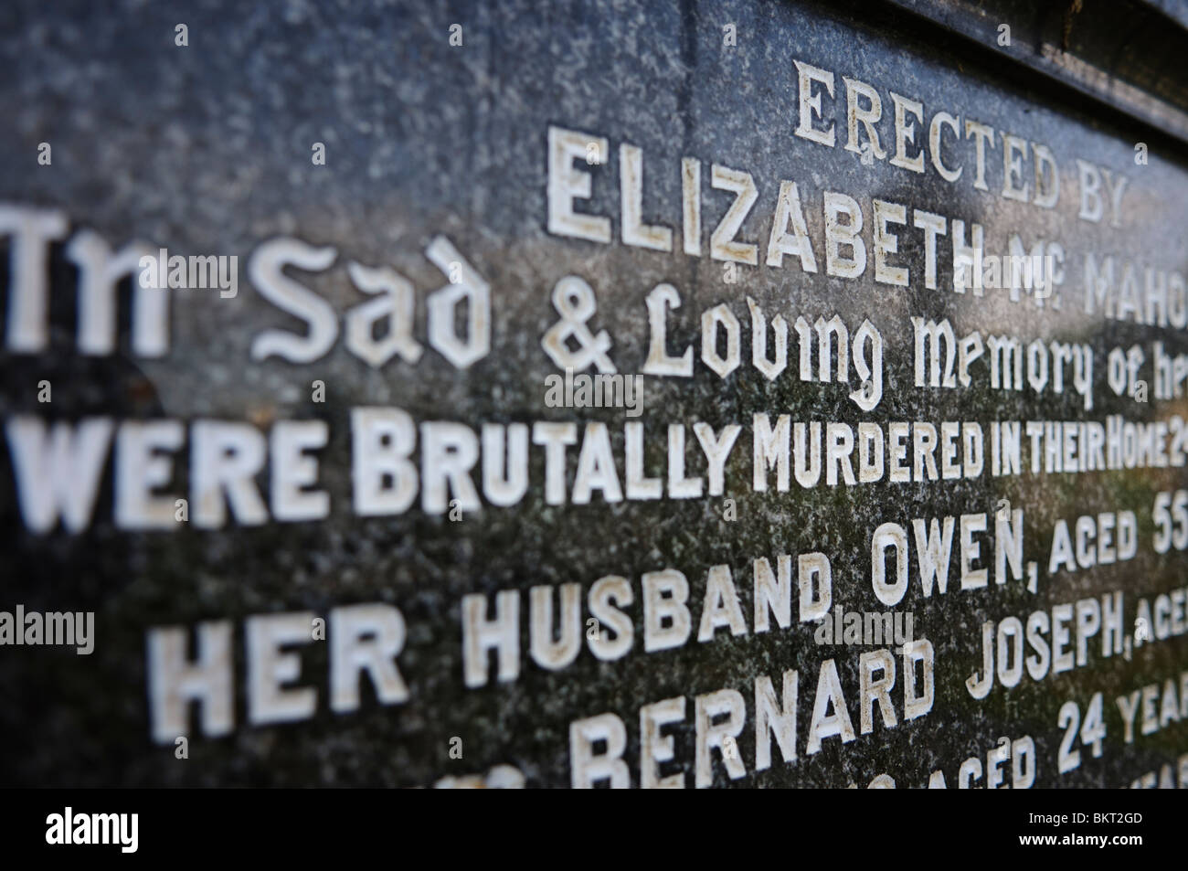 Gravestone inscription with the words 'Brutally Murdered' - Stock Image