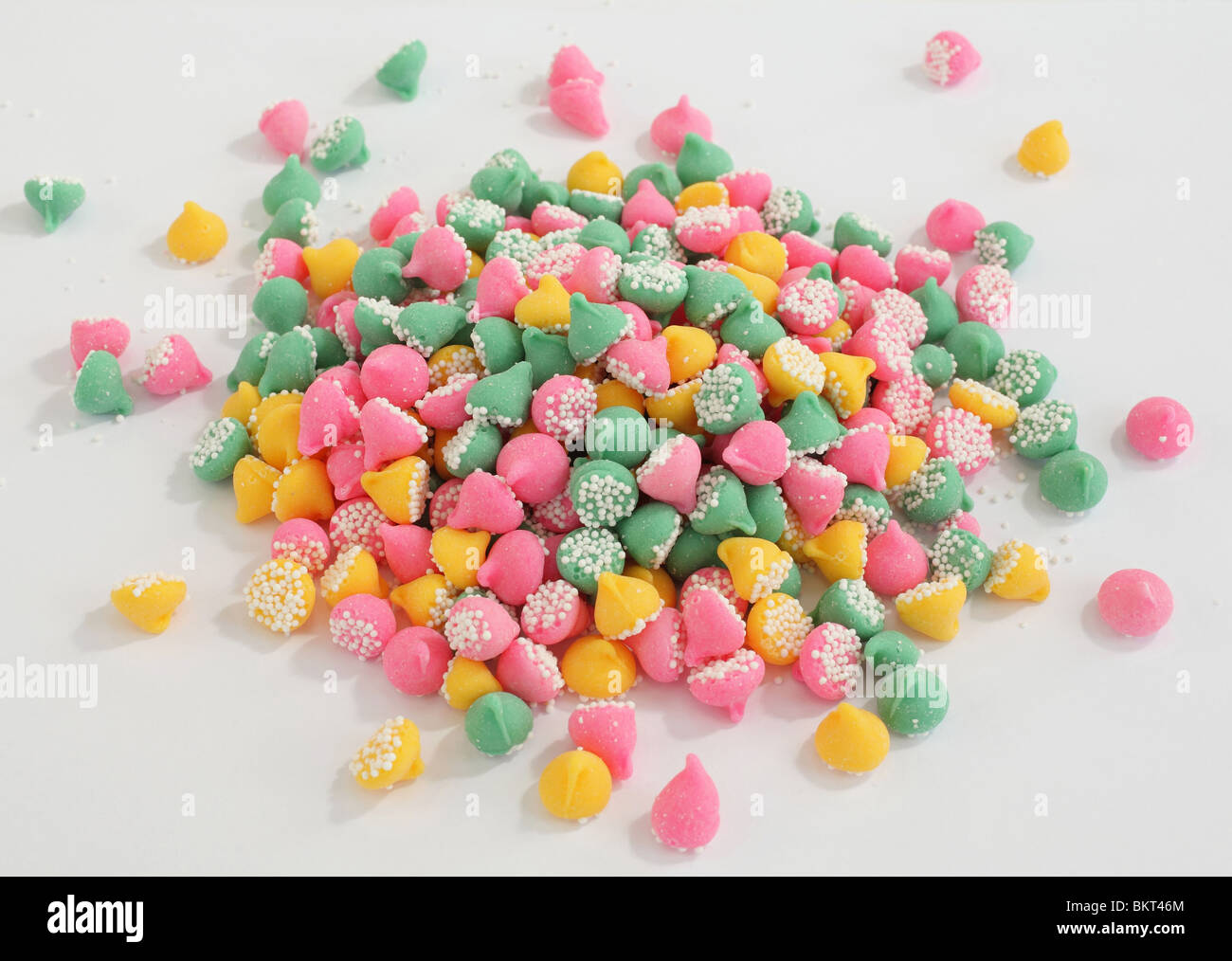large pile of pastel mint cream drops on white background - Stock Image