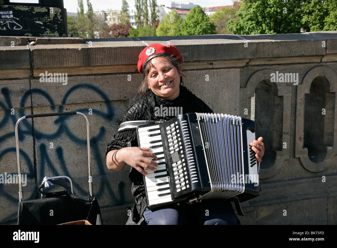Street musician in Berlin, Germany - Stock Image
