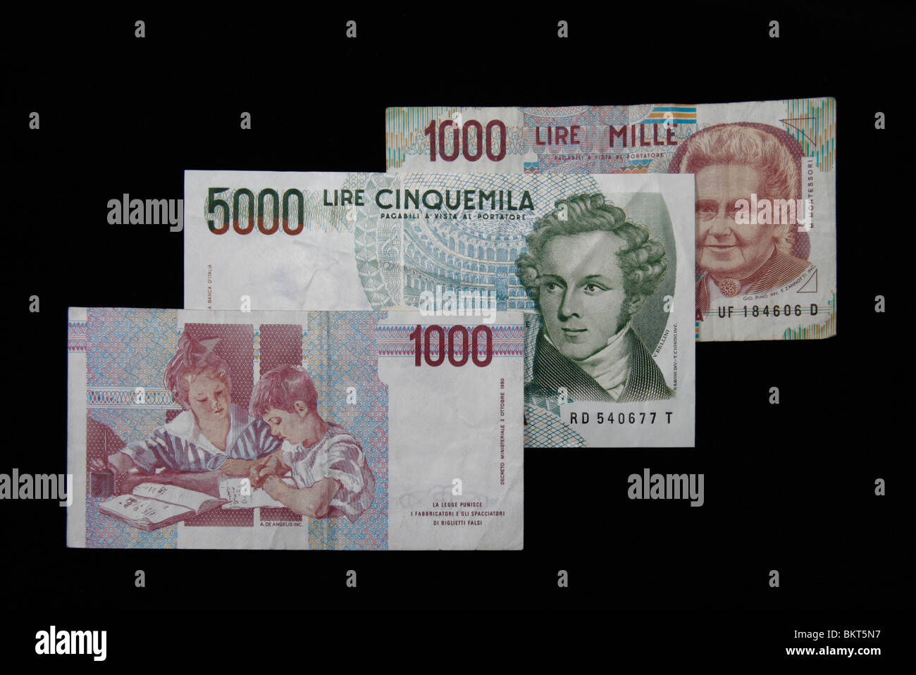 View Of Three Italian Lira Banknotes Replaced By The Euro In 2002 On A Black Background